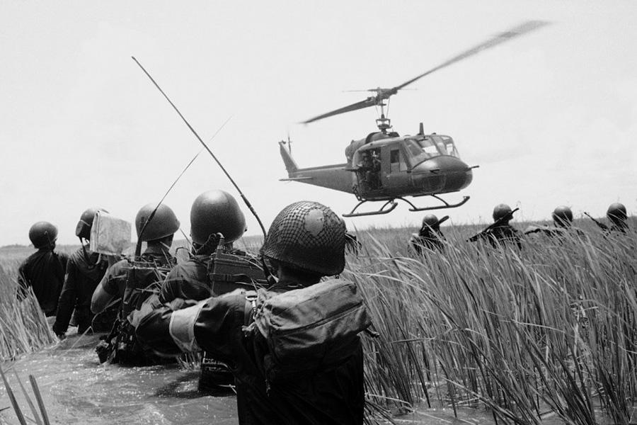 arvn_troops_watching_a_huey.jpg