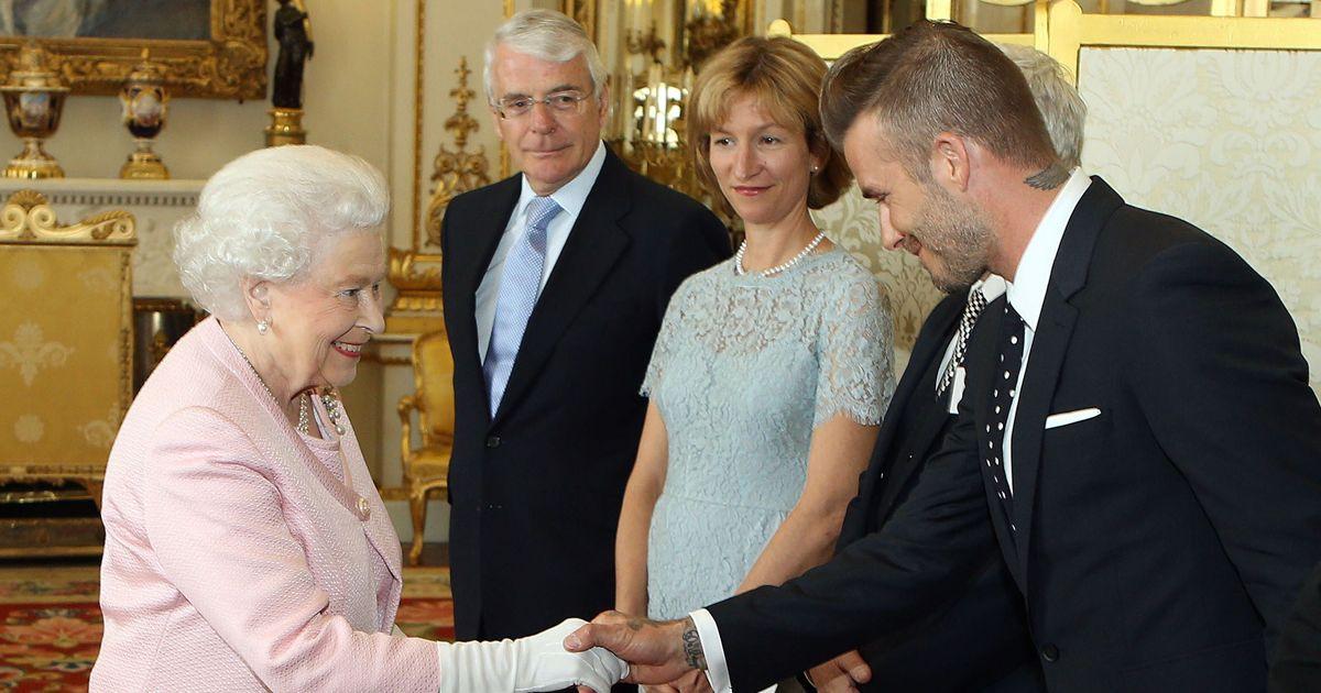 britains-queen-elizabeth-ii-l-shakes-hands-with-former-england-footballer-david-beckham.jpg