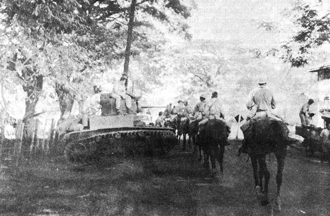 26th_cavalry_pi_scouts_moving_into_pozorrubio.jpg