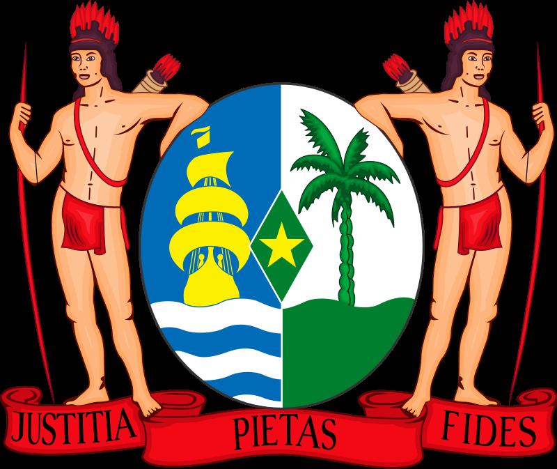 Suriname címere. A két őslakos által tartott pajzs alatt az ország jelszava olvasható: 'Igazság, áhítatosság, hűség'.
