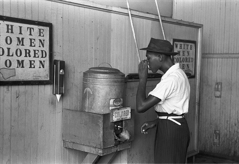 _colored_drinking_fountain_from_mid-20th_century_with_african-american_drinking.jpg
