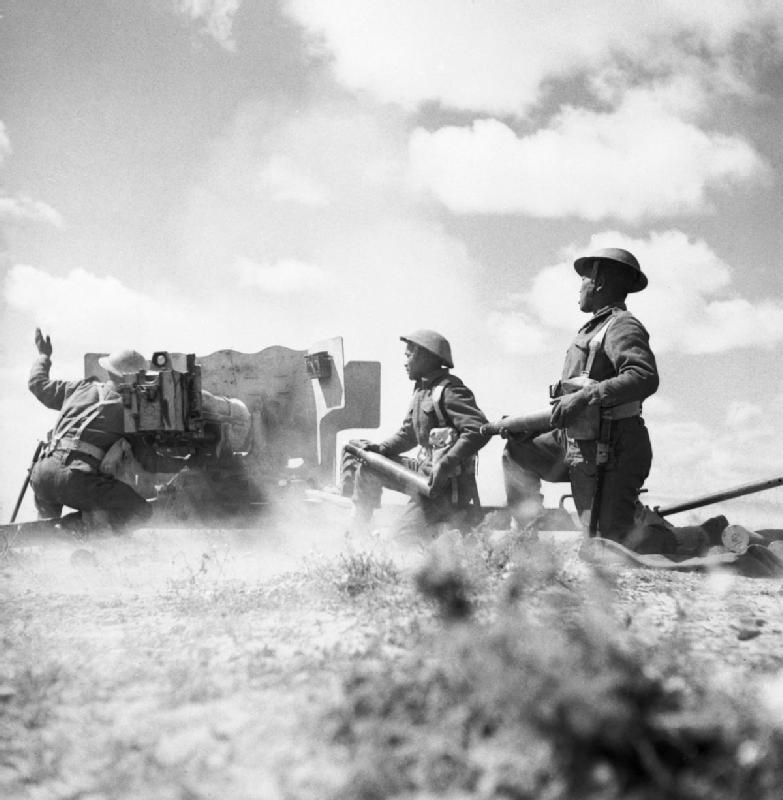 ghurkas_in_action_with_a_6-pdr_anti-tank_gun_in_tunisia_16_march_1943_na1103.jpg