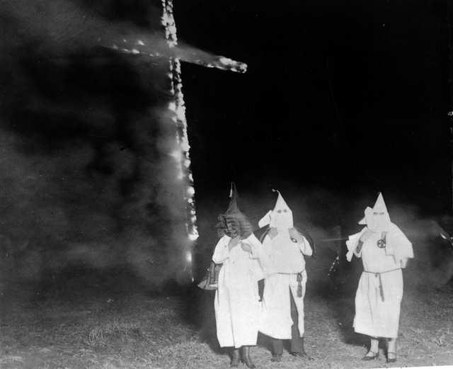 ku_klux_klan_members_and_a_burning_cross_denver_colorado_1921.jpg