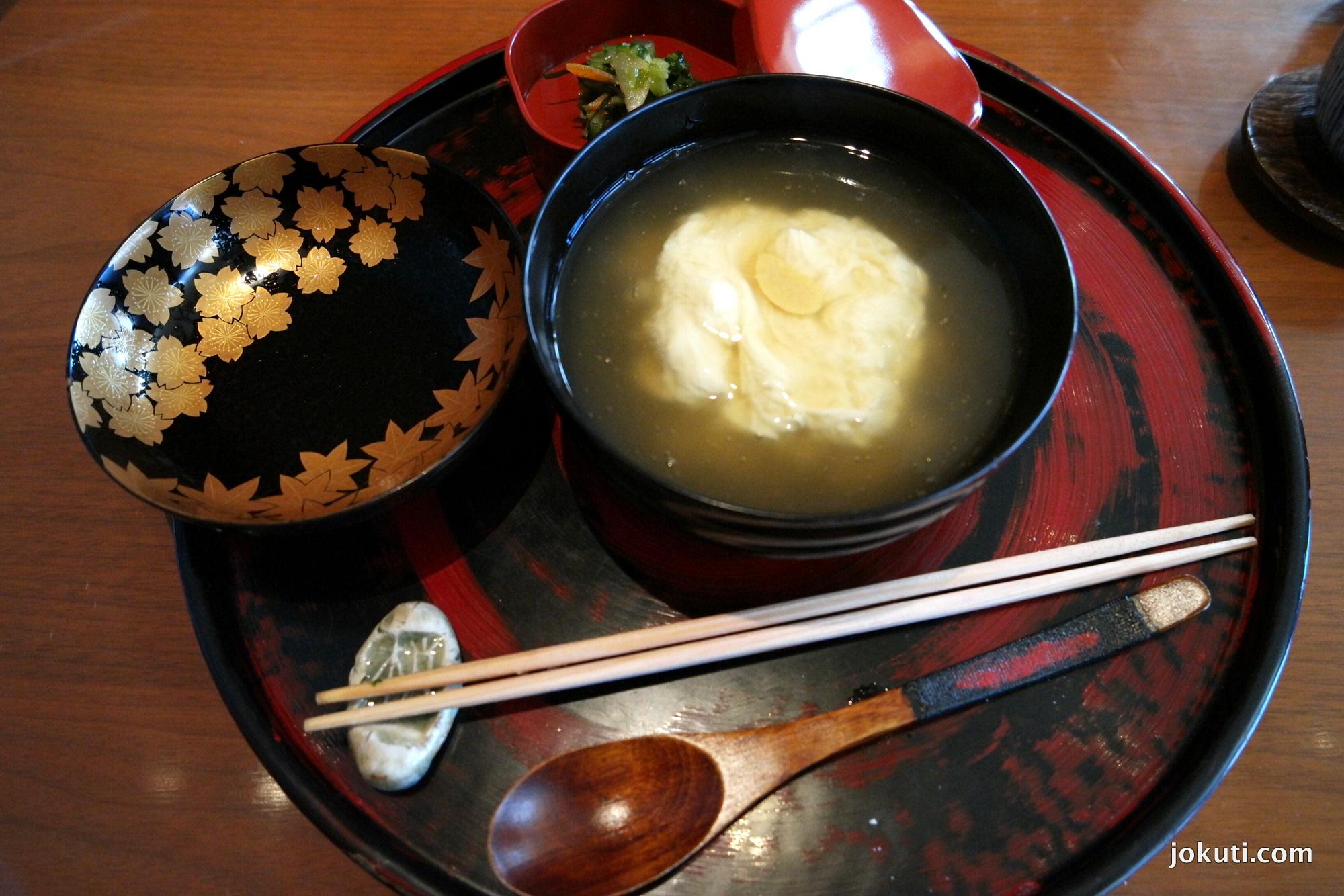 Steamed rice, tofu skin, hot broth, Japanese pickles