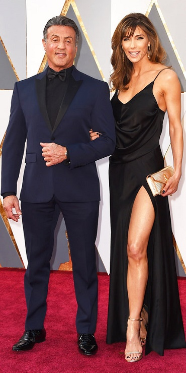 sylvester_stallone_in_yves_saint_laurent_couture_with_wife_jennifer_flavin_in_saint_laurent.jpg