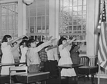 students_pledging_allegiance_to_the_american_flag_with_the_bellamy_salute.jpg