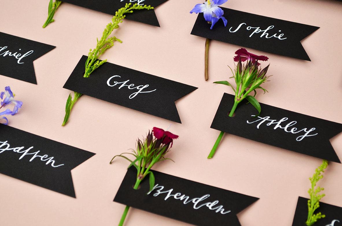 spring-wedding-place-card-ideas-black-paper-flag-tag.jpg