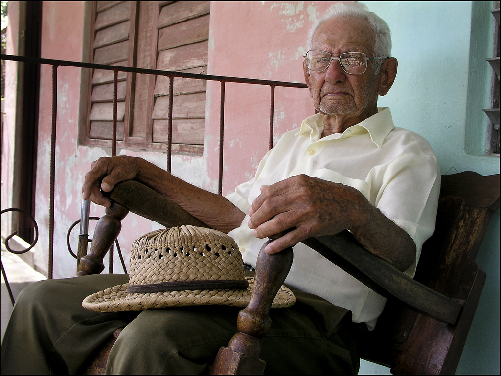 an-old-man-was-sitting-on-his-.jpg