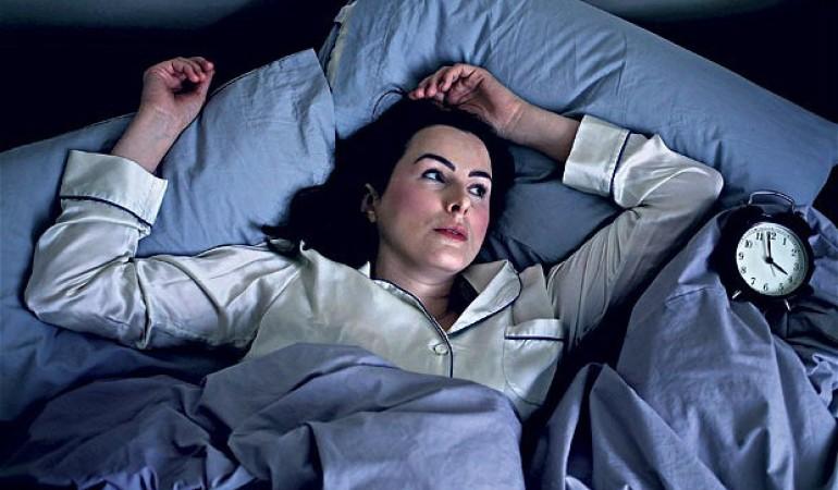 woman-awake-in-bed-770x450.jpg