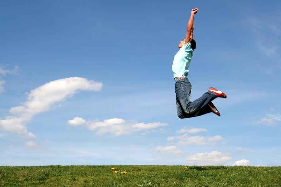 bigstockphoto_man_jumping_against_blue_sky_555552.jpg