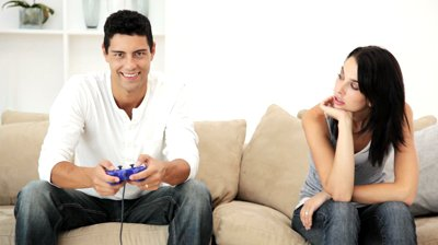 stock-footage-man-playing-video-games-and-ignoring-his-wife.jpg