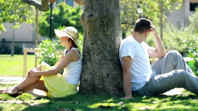 stock-footage-young-couple-sitting-back-to-back-having-relationship-difficulties.jpg